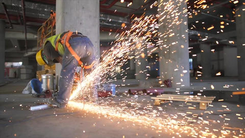Electric wheel grinding on steel structure in construction site Footage