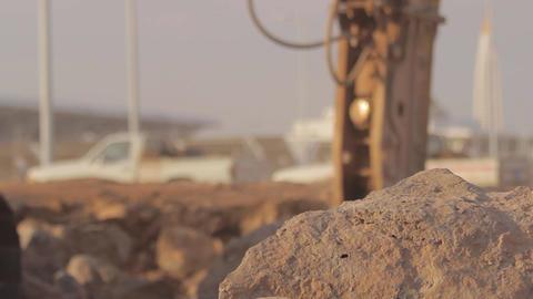 Hydraulic hammer breaker on excavator destroying rocks - Close up Selective Focu Footage