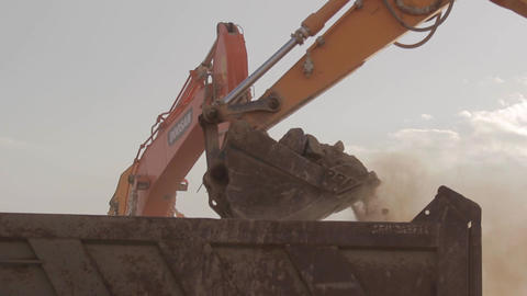 Excavator scoop load s a dump truck and Rock hammer Footage