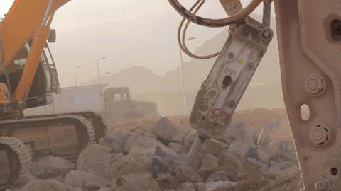 Hydraulic hammer bre aker on excavator destroying rocks Footage