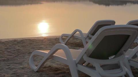 Sunrise at the beach - there are sunbet - tilt Footage