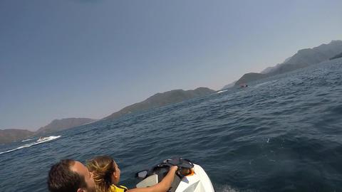 Couple drive jet-ski - Slow Motion Footage