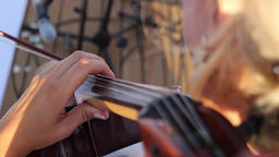A girl plays a cello Footage