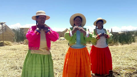 Local women on Lake Titicaca singing in native language. October 16, 2012 - Uros Footage