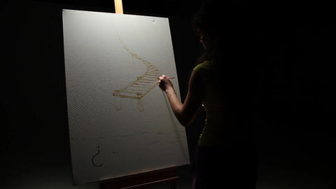 Woman artist painting with paintbrush in Studio Footage