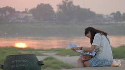 Tourist lady looking on map at sunset,Vientiane,Laos Footage