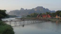Packed motorcycle crossing bamboo bridge,Vang Vieng,Laos Footage