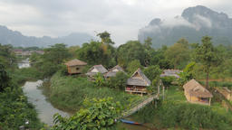 Tourist bungalows and karst mountains early morning,Vang Vieng,Laos Footage