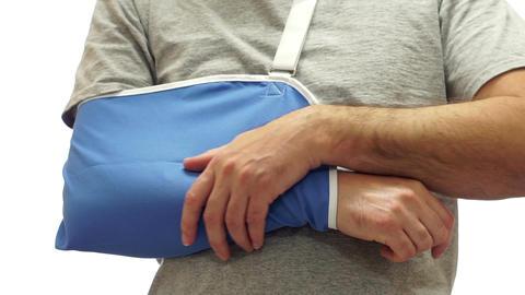 Man Rubs Sore Arm in Medical Sling Stock Video Footage
