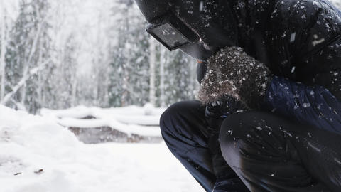 Man welds parts outdoors in winter Footage