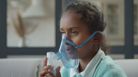 Girl inhaling drugs to treat respiratory diseases Footage