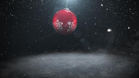 Animated closeup white snowflakes and red ball on dark background Videos animados