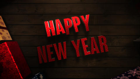 Animated closeup Happy New Year text, gift boxes and green tree branches on wood background Videos animados