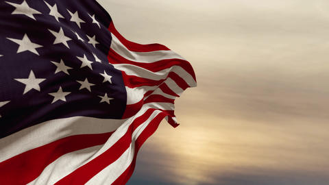 American flag flutters in the wind against the sunset sky, clouds time lapse Archivo
