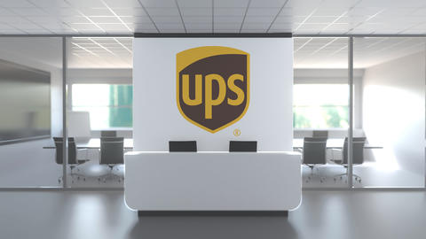 UPS logo above reception desk in the modern office, editorial conceptual 3D Live Action