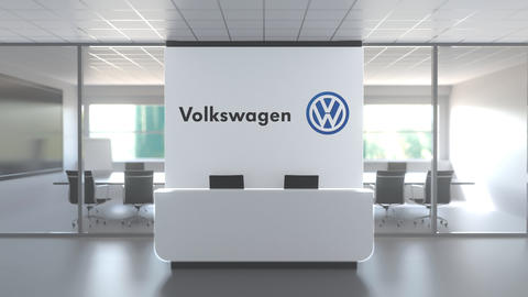 VOLKSWAGEN logo above reception desk in the modern office, editorial conceptual Live Action