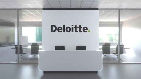 DELOITTE logo above reception desk in the modern office, editorial conceptual 3D Live Action