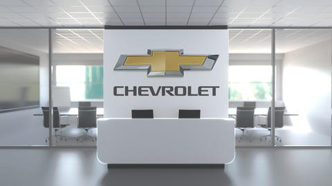 Logo of CHEVROLET on a wall in the modern office, editorial conceptual 3D Live Action