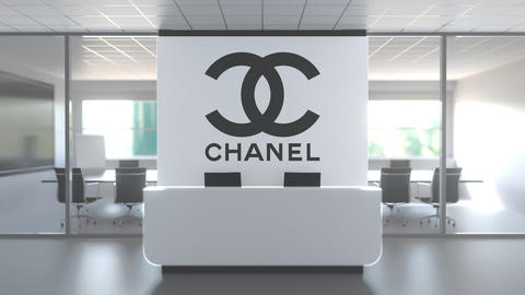 CHANEL logo above reception desk in the modern office, editorial conceptual 3D Live Action