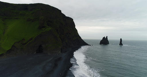 Iceland Aerial drone video of famous black sand beach Reynisfjara with people Footage