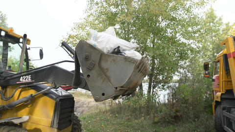 Volunteers on special equipment remove garbage in nature 005 Live Action