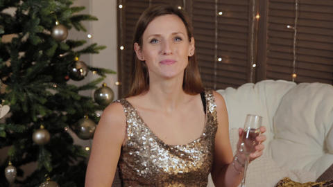 Beautiful happy girl with champagne in a New Year's decor. New Year 2020 Live Action