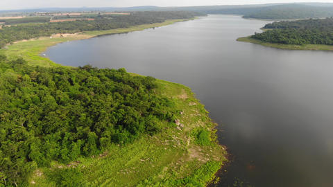 Drone shot aerial view scenic landscape of a reservoir dam at the countryside Live Action