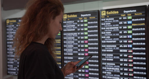 Barcelona, Spain - October 20, 2019: Flight delay. Woman passenger looking at Archivo