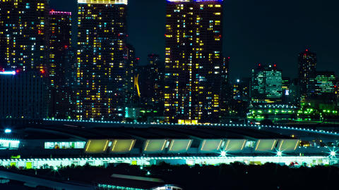 A night timelapse of the cityscape at the urban town in Ariake Tokyo long shot Footage