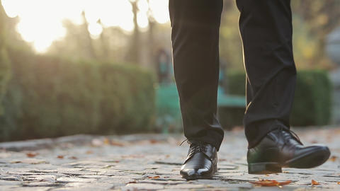Man in black shoes stepping forward Person moving forward outdoor. Walking on Live Action