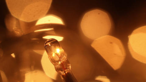 christmas lightbulb slowly blinking extremly close-up loopable Live Action