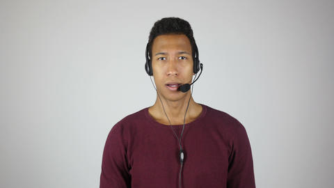 Serious Call Center Operator Talking to Customer Footage