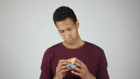 Solving Rubik cube, Intelligent Young Man Footage