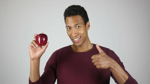 Healthy Lifestyle, Man Showing Red Apple and Thumbs Up Gesture Footage