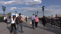 Painting expo on Patriarshy Bridge, cultural and rest place in Moscow downtown Footage