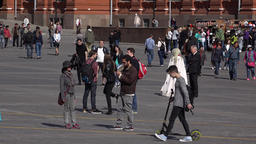 Unidentified people stroll at central square, telephoto shot of sightseers Footage