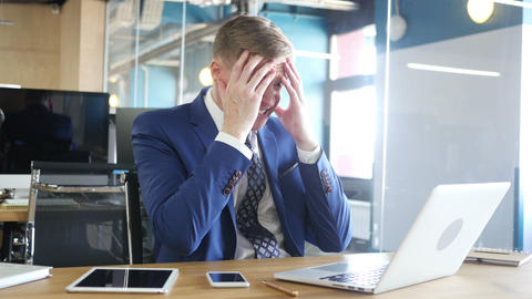 businessman gets very bad news on his laptop screen, Frustration Live Action