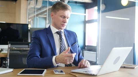 Businessman chatting on computer in the office Footage