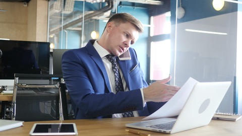 businessman doing multitasking , working with documents , laptop and phone Footage