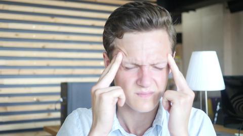 Depressed stressed man having a headache , Feeling awful headache Footage