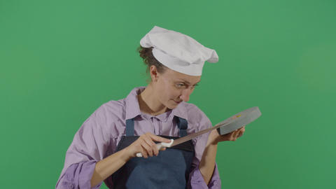 Woman Cook Sharpening A Knife Live Action