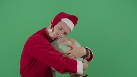 Adult Man Santa Claus Sleeping On A Globe Live Action