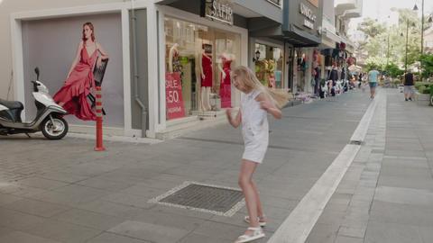 Antalya, Turkey - October 30, 2019: playful girl with long blond hair walking on Archivo