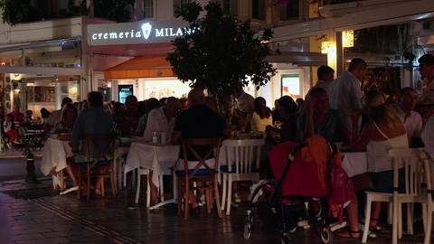 Bodrum, Turkey - October 30, 2019: people dining in outdoor evening cafe Footage