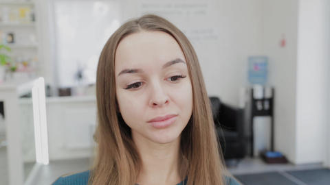 Face of a beautiful girl in a beauty salon before makeup Live Action