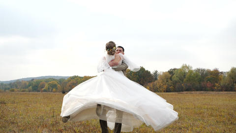 Young Groom spins attractive Bride around in the centre…, Live Action