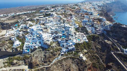 Aerial footage of Oia, Santorini - Famous white houses and blue domes on the edg Footage