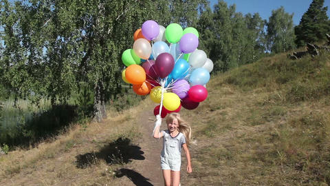 Little girl with balloons running Live Action