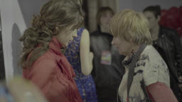 Backstage fashion show. The designer adjusts the clothes on a girl model Footage
