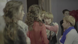 Designers and female models before the show. Backstage fashion show Footage